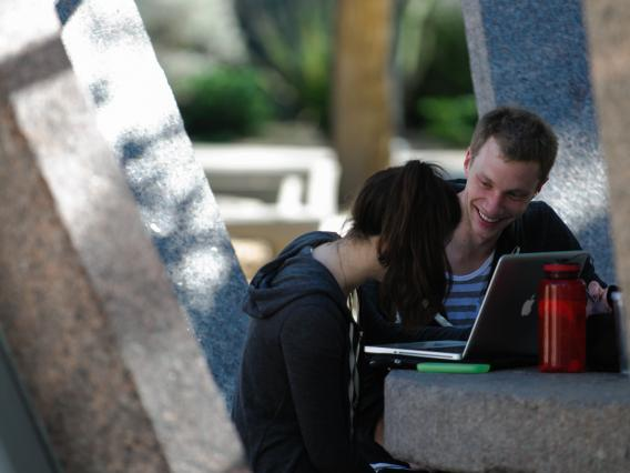 two students outside studying