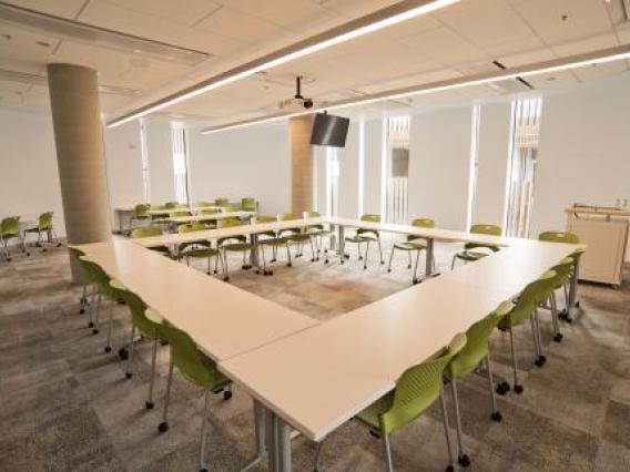 Tables arranged in a square in videoconference room
