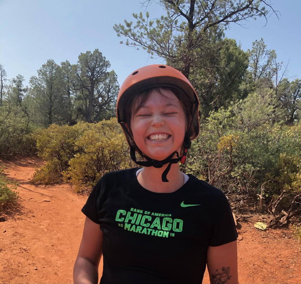 Peyton Smith smiling on a Sedona mountain bike trail