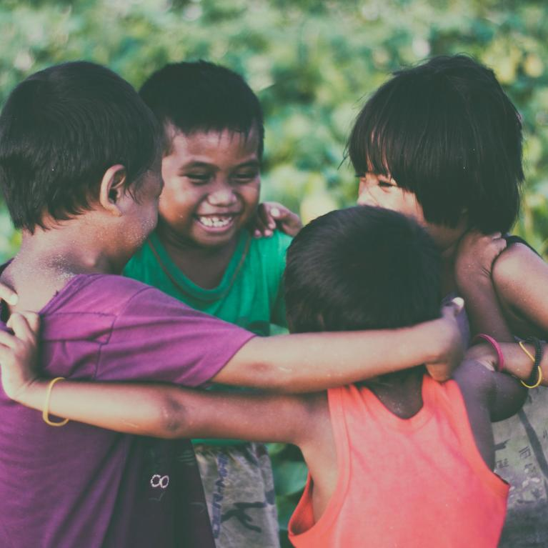 Children smiling in a circle